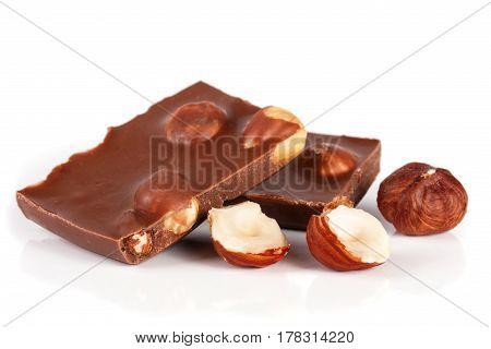 Chocolate with hazelnuts isolated on white background.