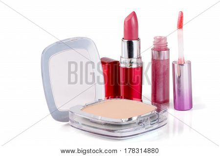 Make-up powder, lipstick and lip gloss isolated on white background.