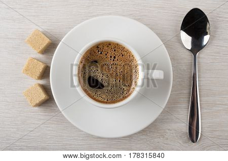 Black Hot Coffee In Cup, Brown Lumpy Sugar And Spoon