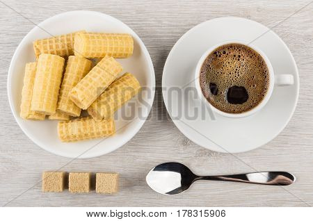 Coffee In Cup, Pieces Of Sugar, Wafer Rolls In Saucer