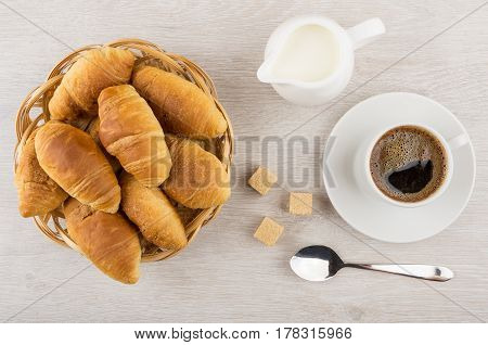 Coffee Cup, Lumpy Sugar, Jug Milk, Croissants In Wicker Basket