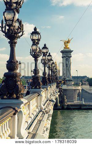 PARIS - SEPTEMBER 20, 2013: View of Alexandre III bridge. Alexandre III bridge is one of the top tourist destinations in Paris.