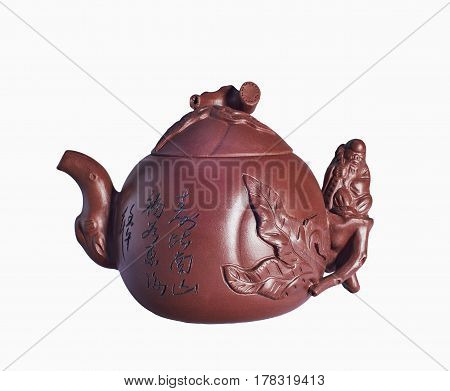 Ceramic teapot from clay handmade. Isolated on a white background