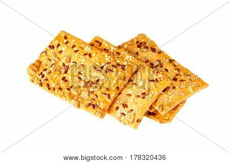 Crispy bread with seeds of sunflower flax and sesame seeds. Isolated on white background