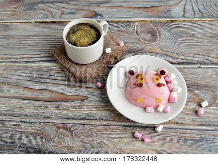 The hippopotamus is made of ice cream and coffee. A creative dessert for children and good mood
