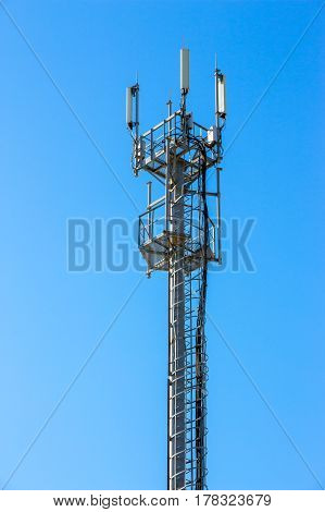 Cell phone tower on blue sky background