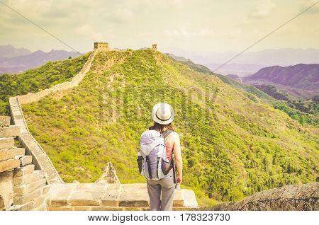 Girl watchin great wall by Jinshanling in China