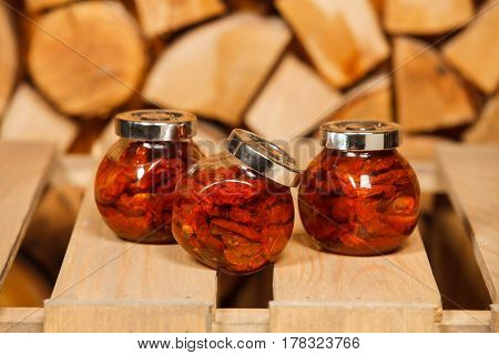 Chili pepper in the jar on wooden table