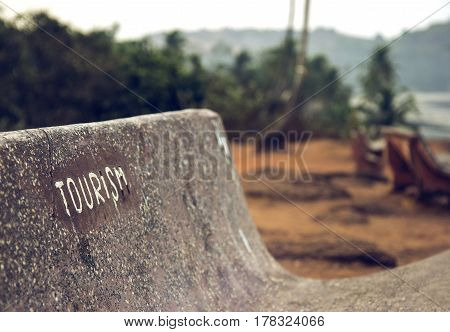 Goa, India. Bench with the word Tourism