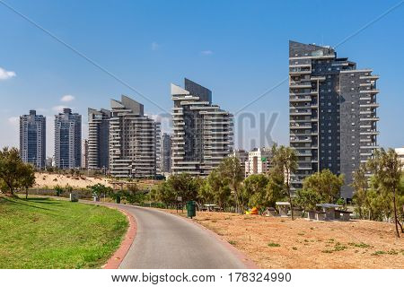 View on modern residential complex of buildings under blue sky in Ashdod, Israel.