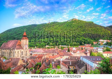 Cityscape Brasov - Beautiful panoramic view over romantic architecture of Black Church and Tampa hill, in Brasov town, Romania