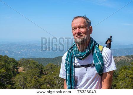 Joyful Bearded Man, Traveler Stands In The Mountains