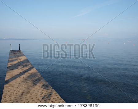 The pier near Lake Garda in the evening in Italy