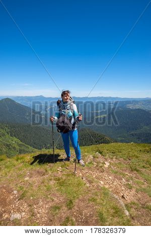 Dreaming Woman, Traveler With Backpack Relax On A Top Of Mountain