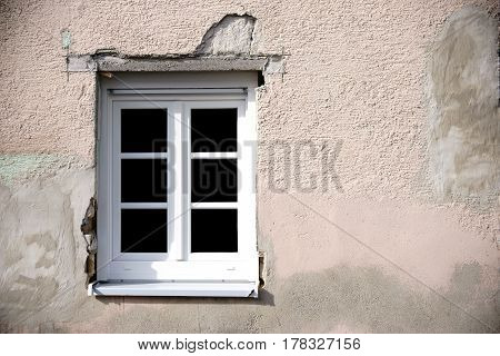 The facade of a house renovation with newly inserted window.
