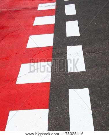 Red and white road marking on the road.