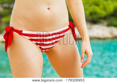 Close up photo of young woman in bikini