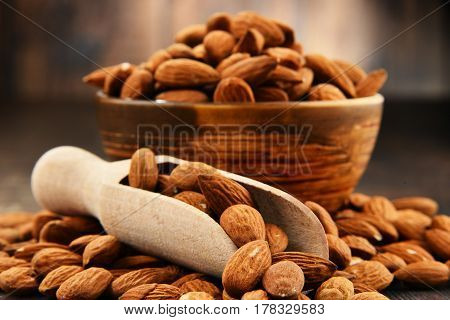 Bowl With Shelled Almonds On Wooden Table