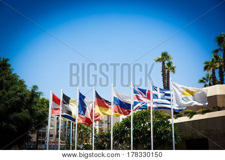 Flags of different countries on the blue sky background