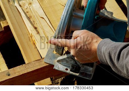 Circular Saw Is Rotating Saws, Hands Gloves, Outdoor
