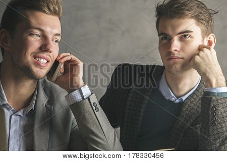 Handsome Boys On Phone Doing Paperwork