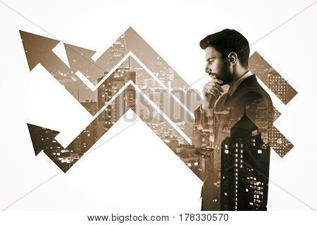 Side portrait of thoughtful young man with arrows on city background. Growth concept. Double exposure