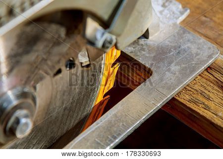 Construction Worker Using Saw Or Circular Saw For Cutting Wood
