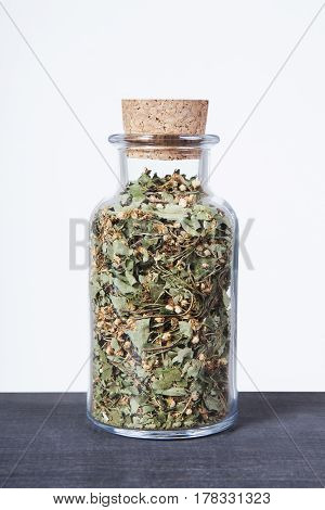 Dried hawthorn herb inside a glass jar. Herbs and plants for tea.