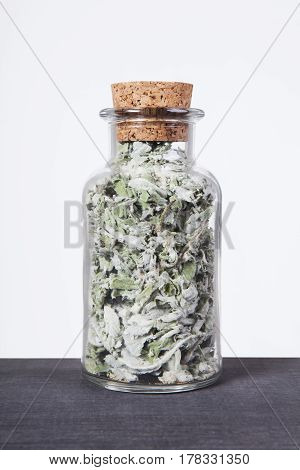 Dried mint herb inside a glass jar. Herbs and plants for tea.