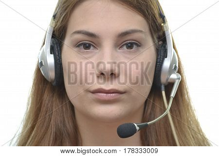 Young redhead woman working as an operator in the Call center