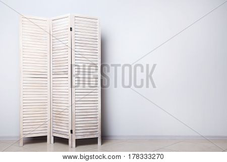 Wooden Folding Screen On A Grey Background