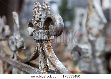 Old rusty metal cemetery fence. Close up.