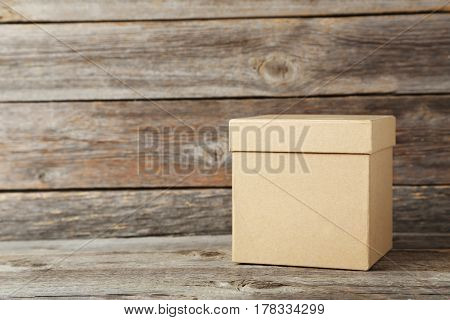 Brown box on a grey wooden table