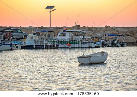 Sunset Over Fishing Boats In Sea Harbor