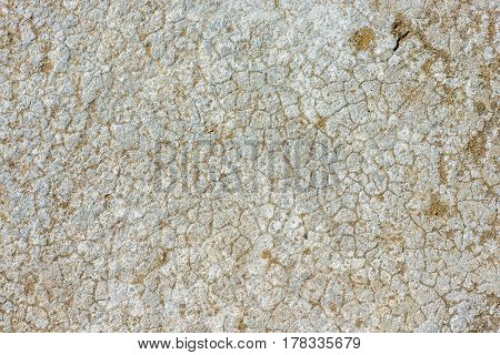 Old cracked concrete texture with sand in fissures
