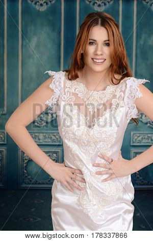 portrait of a happy bride in lace dress