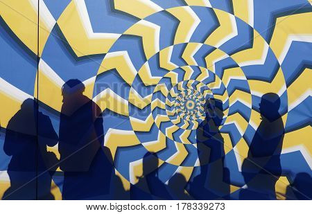 STOCKHOLM SWEDEN - MAR 25 2017: Silhouette of people behind a colorful psychedelic abstract startgate waiting for the start in the Stockholm Tunnel Run Citybanan 2017. March 25 2017 in Stockholm Sweden