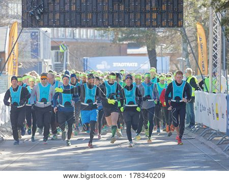 STOCKHOLM SWEDEN - MAR 25 2017: Running people after the start in the Stockholm Tunnel Run Citybanan 2017. March 25 2017 in Stockholm Sweden