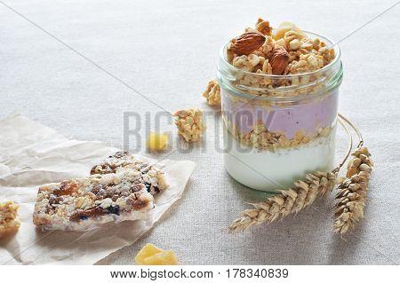 greek yogurt with fruit crunchy with bilberry muesli bar breakfast healthy food concept