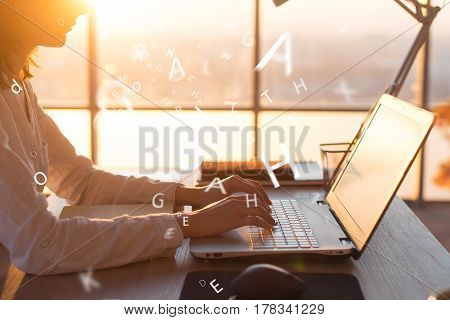 Female hands on keyboard texting using laptop and internet, working online. Freelancer typing at office, workplace
