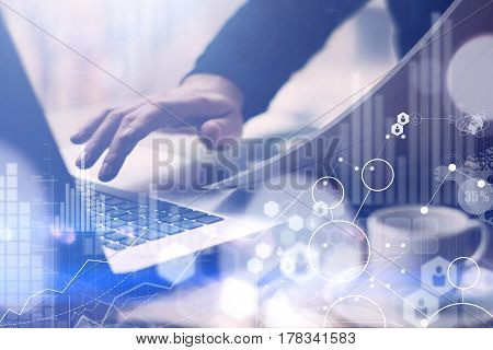 Concept of digital screen, virtual connection icon, diagram, graph interfaces.Businessman using laptop for research new business solutions.Blurred background