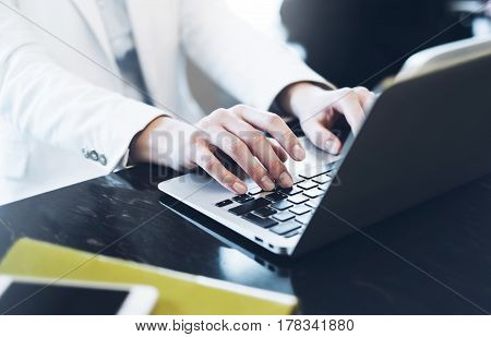 Businesswomen working in office young hipster manager typing on keyboard female hands texting message work process concept in workspace woman writing text on the open monitor laptop in cafe