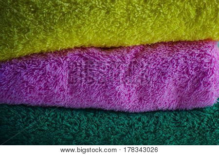 Fresh soft terry multi-colored towels smelling flowers