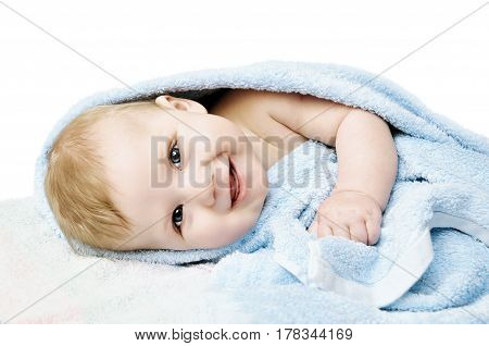 Newborn child relaxing in bed after bath or shower. Nursery for children. Textile and bedding for kids. Clipping Path