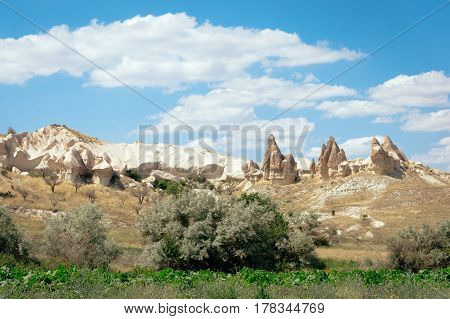 Rock formations landscape photography of Cappadocia in Central Anatolia. The great tourist attraction - mountains in Goreme National Park outdoor Turkey at sunny summer day