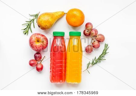 multifruit drink in plastic bottle with fresh fruit on white table background top view mock-up