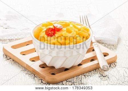 Bowl of creamy homemade macaroni and cheese.