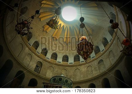 Lampades hang under the main dome of the Church of the Holy Sepulcher