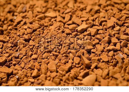 Granules of instant coffee background macro shot
