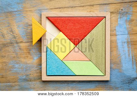 Tangram, a traditional Chinese Puzzle Game made of different wood parts to build abstract figures from them
